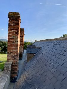 Natural slate roof with gro box gutter